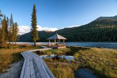 Wooden boardwalk along the lake in the mountains. Wooden boardwalk along Rakhmanovskoe lake in East Kazakhstan, Altai mountains Stock Photo