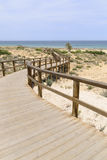 Wooden Boardwalk at Arenales del Sol beach Royalty Free Stock Images