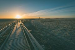 wooden boardwalk with bird watch tower in early morning - vintag Royalty Free Stock Image