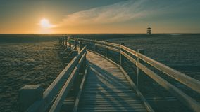 wooden boardwalk with bird watch tower in early morning - vintag Stock Photography