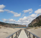 Wooden boardwalk in Cala Domestica Royalty Free Stock Photo