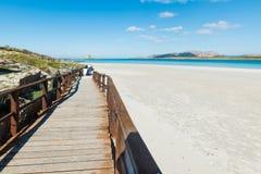 Wooden boardwalk in La Pelosa. Beach, Sardinia Stock Images