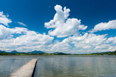 Wooden boardwalk at lake hopfen am see Stock Images