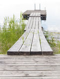 Wooden boardwalk leading out to raft or float Stock Image