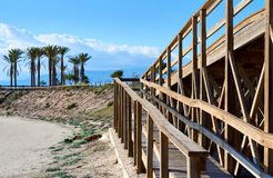 Wooden boardwalk leading to the Retamar beach. Almeria province, Spain Royalty Free Stock Photo