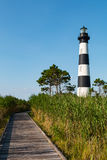 Wooden Boardwalk Through Marshland to Bodie Island Lighthouse stock images