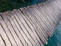 Wooden boardwalk over a brook. Wooden boardwalk over a clean brook Royalty Free Stock Image