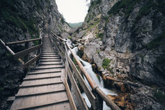 Wooden boardwalk through rocks Stock Photos