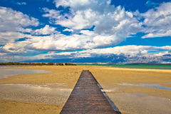 Wooden boardwalk and sand beach of Nin Stock Photos
