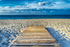 Wooden boardwalk on the sand in hdr Royalty Free Stock Images