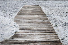 Wooden boardwalk on the sand Stock Images