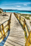 Wooden boardwalk in Sardinia Royalty Free Stock Image