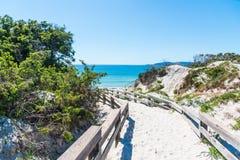 Wooden boardwalk by the sea in Alghero coastline Royalty Free Stock Photography