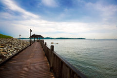 Wooden boardwalk by the sea Royalty Free Stock Photo