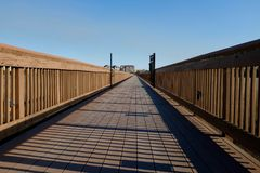 Wooden Boardwalk to Coastal Homes Royalty Free Stock Photo