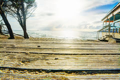 Wooden boardwalk by the shore Stock Image