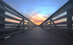 Wooden Boardwalk at sunset at Bolsa Chica Royalty Free Stock Image