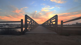 Wooden Boardwalk at sunset at Bolsa Chica Stock Photography