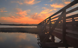 Wooden Boardwalk at sunset at Bolsa Chica Royalty Free Stock Photography