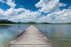 Wooden boardwalk at swim lake hopfen Royalty Free Stock Photography