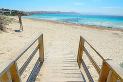 Wooden boardwalk to the beach in Capo Testa Royalty Free Stock Photo
