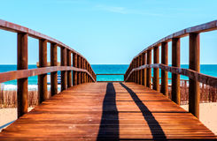 Wooden boardwalk to the beach. Idyllic scene Royalty Free Stock Photo