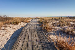 Wooden boardwalk to the beach Stock Photo