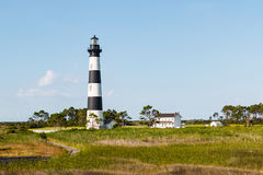 Wooden Boardwalk Trail Through Marshland to Bodie Island Lighthouse. A wooden boardwalk trail through marshland leading to the Bodie Island lighthouse and stock image