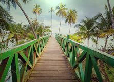 Boardwalk on the beach. Wooden boardwalk on the tropical beach in Costa Rica, Central America Stock Images