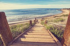 Boardwalk on the beach. Wooden boardwalk on the tropical beach in Costa Rica, Central America Stock Photos