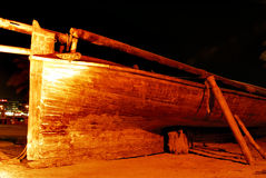 Wooden boat. A damaged wooden boat at the shipyard Stock Images