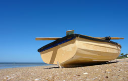Wooden Boat. Small Wooden Boat lying on the beach Royalty Free Stock Image