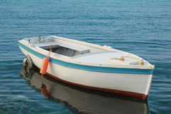 Wooden boat. Small wooden boat on the blue Adriatic sea Stock Photo
