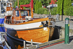 Wooden boat. Beautiful wooden boat lying at the Halden pier. During the annual food and wooden boat festival in Halden, I discovered this boat. This is a great Stock Image