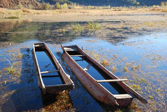 Wooden boat. Two abandon wooden boat, calmly depending on shore.here is the Chinese Sichuan is beautiful, original ecology Lugulake Royalty Free Stock Photos