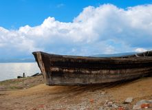 Wooden boat. Abandoned old rotten boat. Coast of the Lake Baikal Royalty Free Stock Images