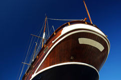 Wooden boat against the sky. Royalty Free Stock Photo