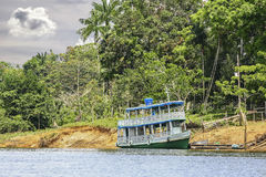 Wooden boat on the Amazon river, Brazil. Stock Image