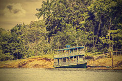 Wooden boat on the Amazon river, Brazil, vintage retro instagram Royalty Free Stock Images