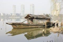 Wooden boat anchoring bank with its refelctor(Jiaxing,China) Stock Photo