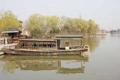 Wooden boat anchoring bank with its refelctor(Jiaxing,China) Royalty Free Stock Photos