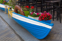 Wooden boat as a scenery of a street cafe. Architecture stock images