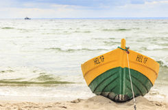 Wooden boat on The Baltic shore Stock Photography