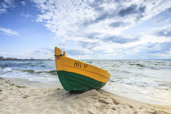 Wooden boat on The Baltic shore. Wooden boat on The Baltic shore, Hel Peninsula Royalty Free Stock Images