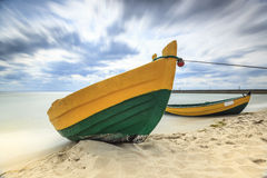 Wooden boat on The Baltic shore. Royalty Free Stock Photo