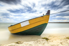 Wooden boat on The Baltic shore. Royalty Free Stock Photography
