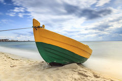 Wooden boat on The Baltic shore. Stock Image