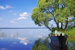 Wooden boat on the bank of lake Royalty Free Stock Photo