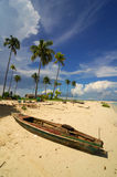 Wooden boat on the beach. With blue sky in the background Stock Photo
