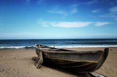 Wooden boat on beach Stock Photos
